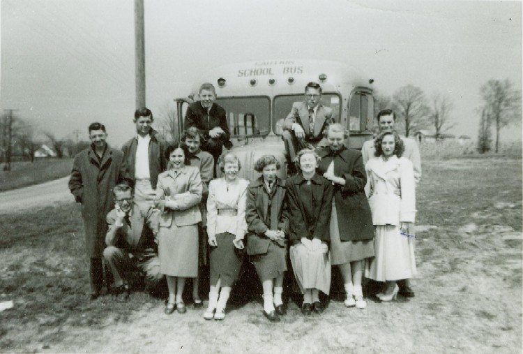 New Haven Class of 1953 in front of school bus